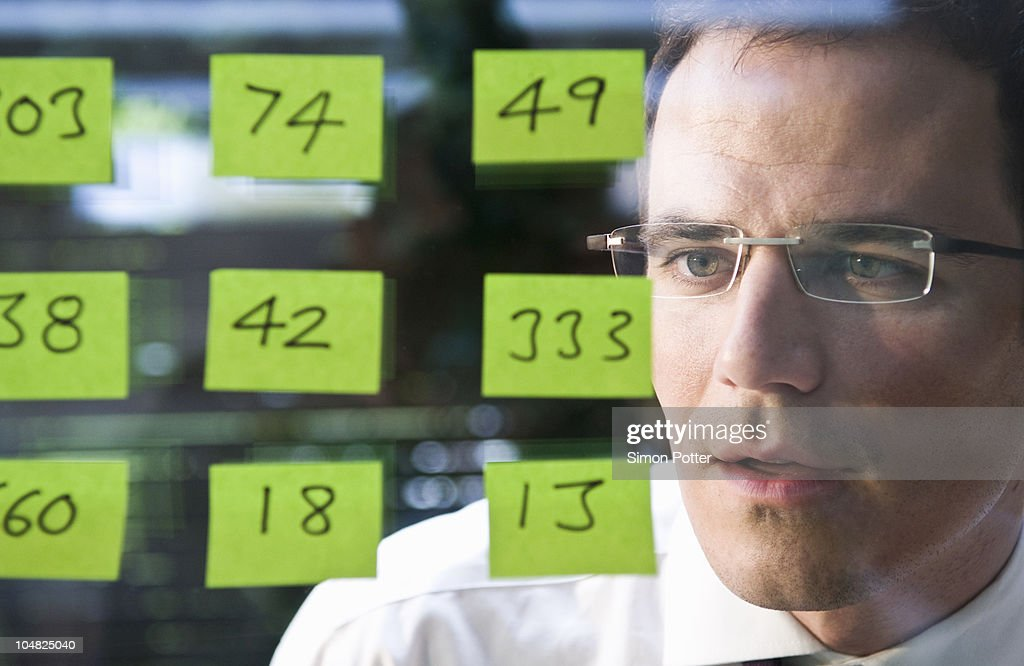 Man looks at yellow stickers : Stock Photo
