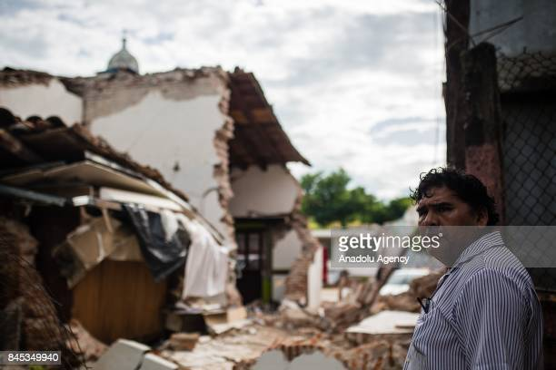 A man looks between the debriss after the earthquake in Juchitan Mexico on 10 September 2017 An earthquake with a magnitude of 82 and epicenter in...