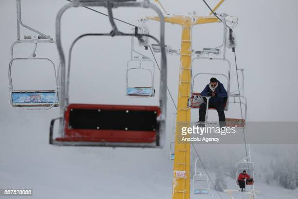A man looks down from a ski lift on a foggy day at Uludag mountain in Bursa Turkey on December 07 2017 Range of vision differs from region to region...