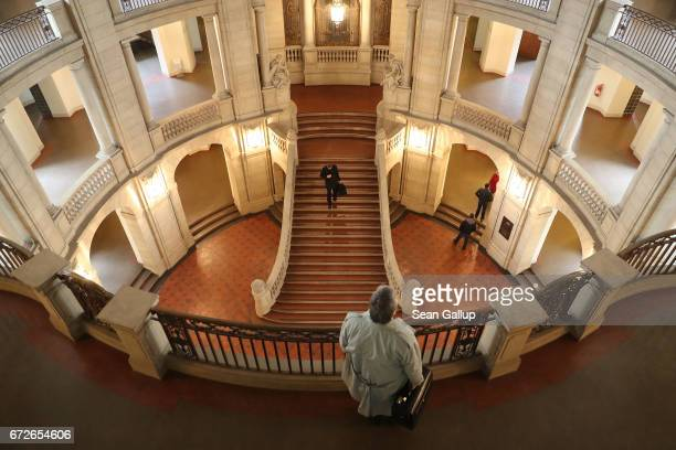A man looks down in the central hall of the Kammergericht courthouse on the first day of a legal appeal by a woman against Facebook on April 25 2017...