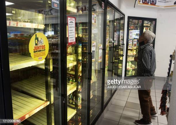 A man looks for a soda drink following the shortage of beer after the breweries countrywide closed their production due to the COVID19 coronavirus in...