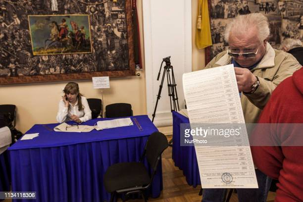 A man looks for his candidate in the ballot during the presidential elections in Kiev Ukraine on 31 March 2019