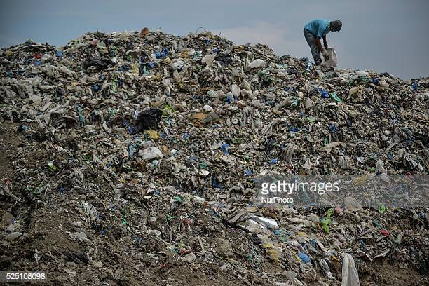 A man looks for recyclables at a garbage dump during World Environment Day in Paranaque south of Manila Philippines June 5 2014 The United Nations...