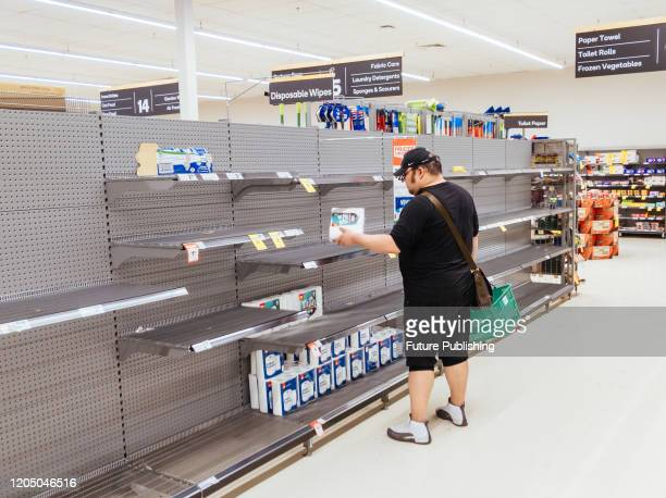 A man looks for toilet paper in an Australian supermarket after panic buying due to the Corona Virus PHOTOGRAPH BY Chris Putnam / Barcroft Studios /...