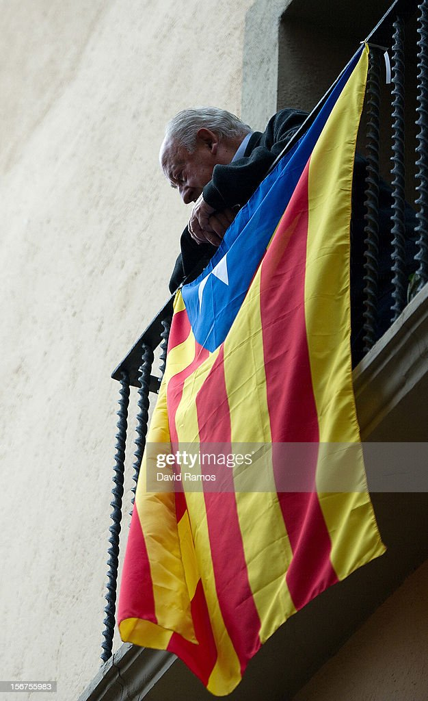 A man looks from his balcony hung with a pro-independent Catalonia flag on November 20, 2012 in Vic, Spain. Catalans will be voting in Parliamentary elections on November 25.