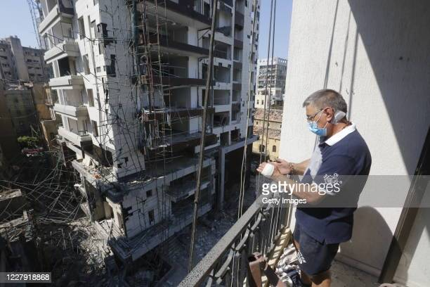 Man looks from the balcony of a building, damaged by an explosion a day earlier, on August 5, 2020 in Beirut, Lebanon. As of Wednesday morning, more...