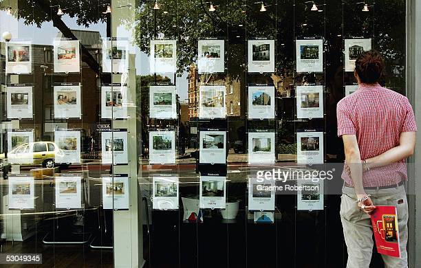 A man looks in an estate agents window June 10 2005 in London England Towards the end of 2004 the most hawkish forecasters were contemplating a fall...