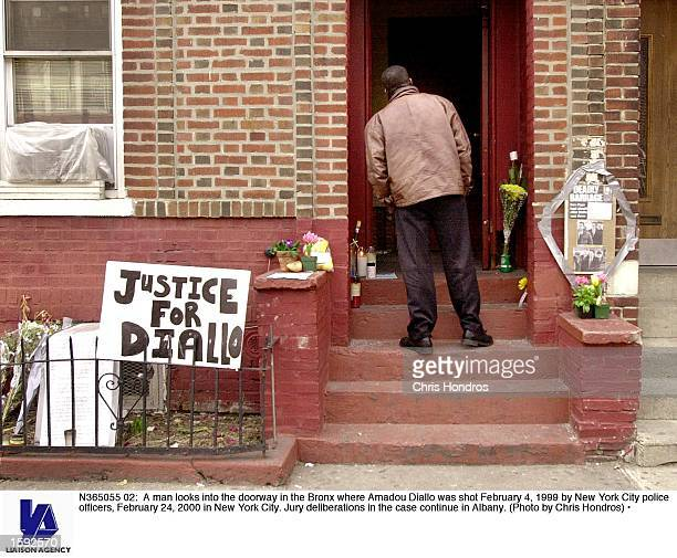 A man looks into the doorway in the Bronx where Amadou Diallo was shot February 4 1999 by New York City police officers February 24 2000 in New York...