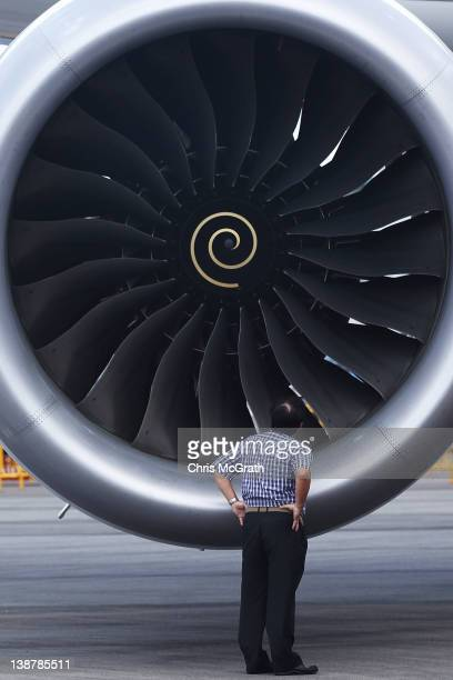 A man looks into the Rolls Royce engine of the Boeing 787 Dreamliner during a media tour on February 12 2012 in Singapore The 787 Dreamliner will be...