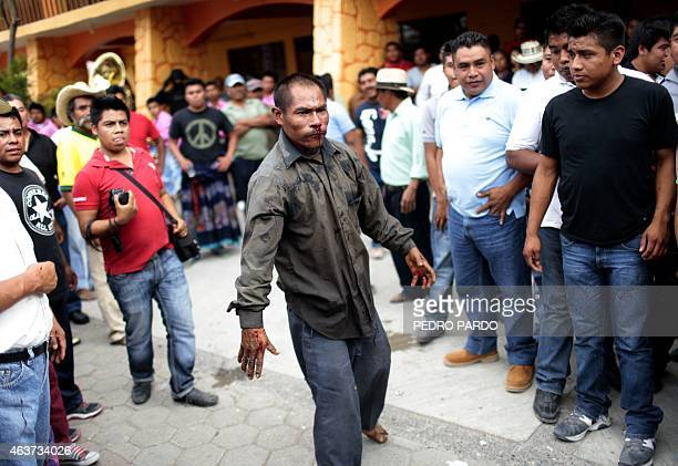 A man looks on after taking part in a fight representing the Xochimilcas fight to defend their women against the Aztecs in the Mexican municipality...