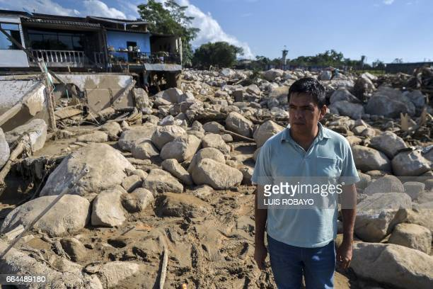 A man looks on amid rubble caused by mudslides due to heavy rains in Mocoa Putumayo department southern Colombia on April 4 2017 Colombian government...