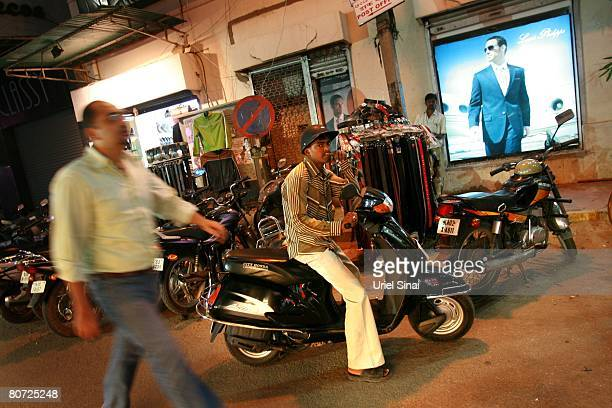 A man looks on as he sits on his motorcycle on April 11 2008 in Bangalore India Many residents work for multinational cooperations and the economy is...