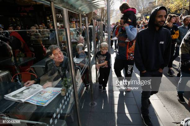 A man looks on as the the 2017 NAIDOC March heads down Swanston Street on July 7 2017 in Melbourne Australia The march was organised to call for a...