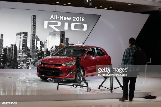 A man looks on at a display of the 2018 Kia Rio automobile during 2017 New York International Auto Show Press Day at Jacob K Javits Convention Center...