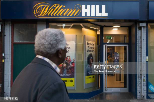 A man looks on at a William Hill betting shop on July 4 2019 in Cardiff Wales William Hill has announced plans to close 700 betting shops putting...