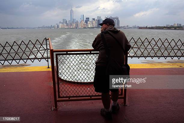 Man looks out at the island of Manhattan from the Staten Island Ferry on June 11, 2013 in New York City. In a highly anticipated speech, New York...