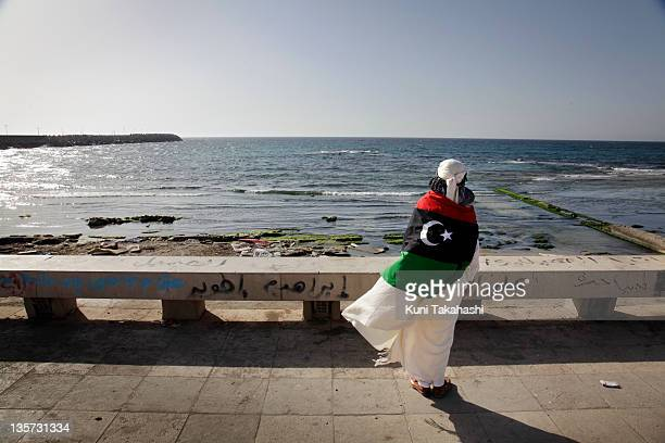 A man looks out at the Mediterranean Sea May 21 2011 in Benghazi Libya ProCol Moammar Gadhafi forces have unleashed their biggest attack Saturday...