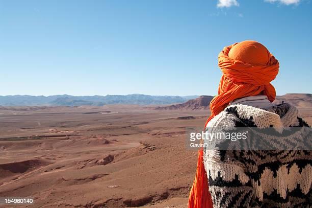 Man looks out at wilderness on edge of Sahara Desert