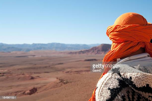 Man looks out at wilderness on edge of Sahara Desert