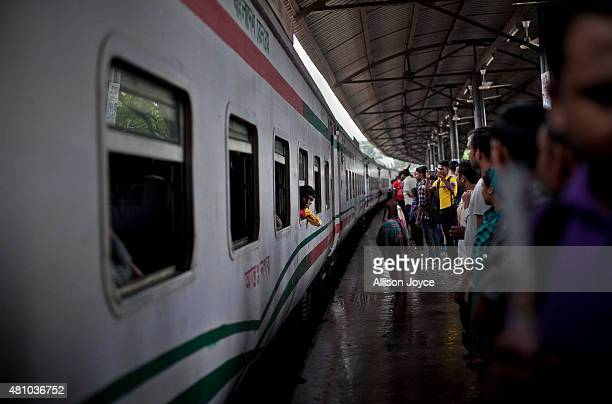 A man looks out from a train window as Bangladeshi Muslims head home to their respective villages ahead of Eid AlFitr July 17 2015 in Dhaka...