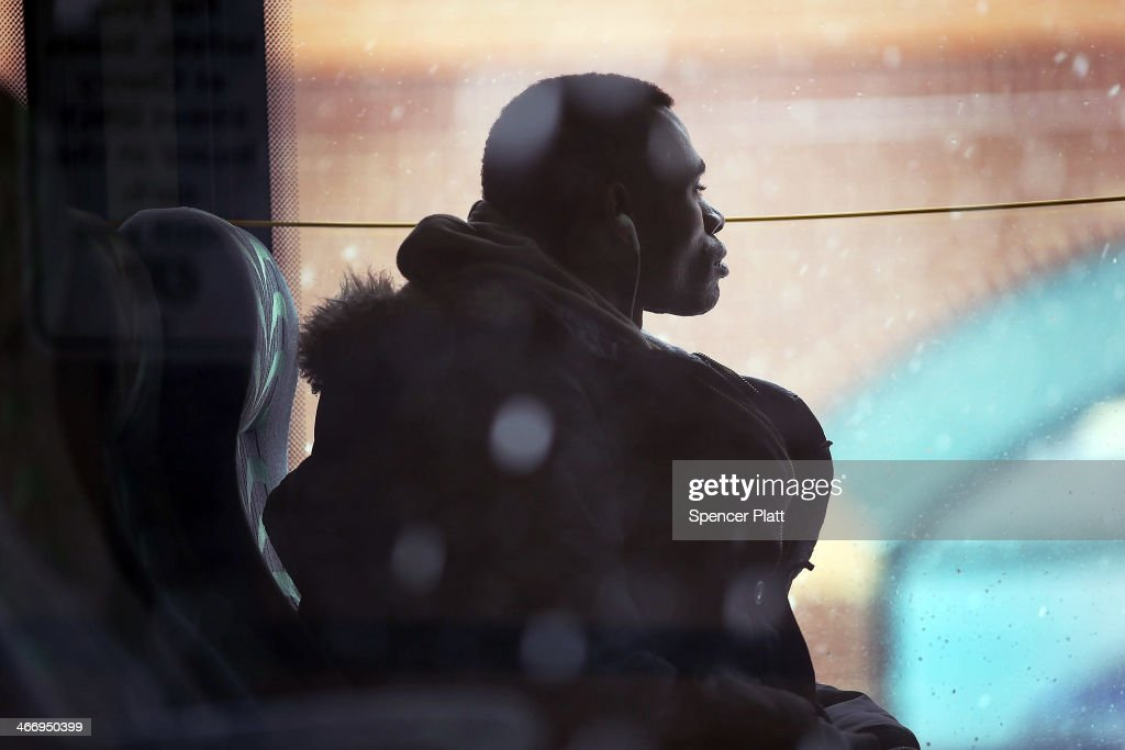 A man looks out of a bus window during a snow storm on February 5, 2014 in Burlington, Vermont. Burlington, and much of the Northeast, received another mix of wintery weather on Wednesday causing traffic accidents and hundreds of flight cancelations.