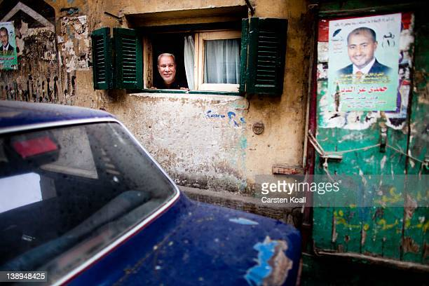 A man looks out of a small window on February 14 2012 in Cairo Egypt In times of revolution Egypt's tourism has lost 30 percent to 40 percent Tourism...