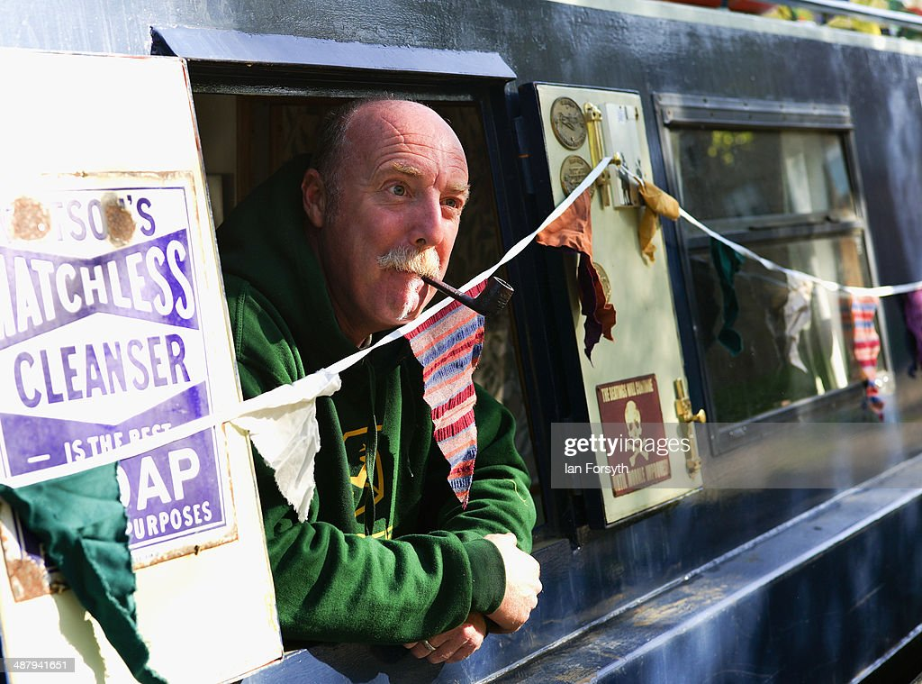 A man looks out of the hatch on his narrowboat during the Skipton Waterway Festival on May 3, 2014 in Skipton, England. The Waterway festival is a three day annual canal boat event held on the Leeds and Liverpool canal. The event brings together boaters and the local community who take part in the festival activities.