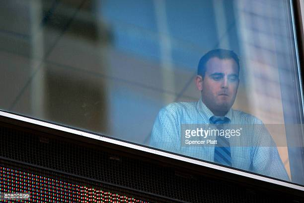 Man looks out of the window of the Lehman Brothers building September 15, 2008 in New York City. Lehman Brothers filed a Chapter 11 bankruptcy...