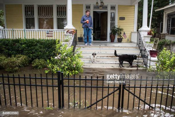 A man looks out over storm surge flood waters from Hurricane Irma along the St Johns River on September 11 2017 in Jacksonville Florida Flooding in...