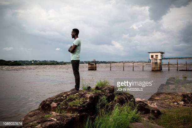 Man looks out over the Congo River on January 18 in Kinshasa.