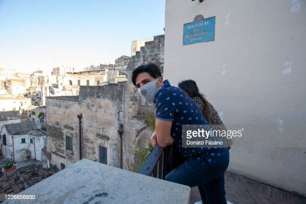 A man looks out over the Sassi of Matera from Belvedere Luigi Guerricchio on May 23 2020 in Matera Italy Restaurants bars cafes hairdressers and...
