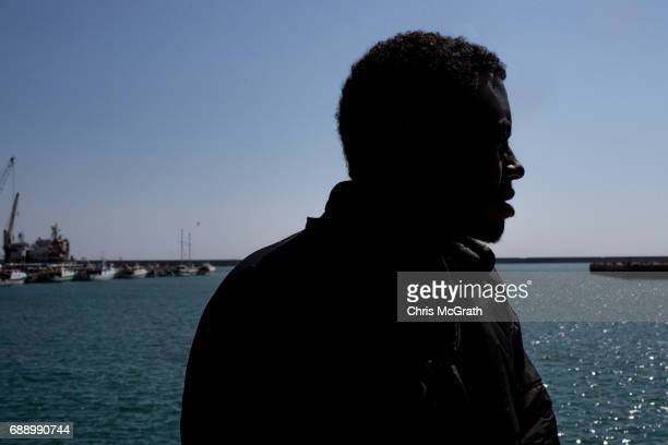 A man looks out to sea after reaching Italy aboard the Migrant Offshore Aid Station 'Phoenix' vessel on May 27 2017 in Crotone Italy The refugees and...