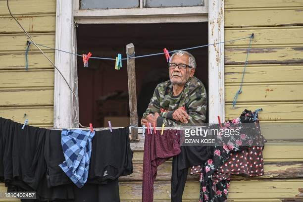 A man looks outside from his window in Istanbul on April 19 as Turkish government announced a twoday curfew to prevent the spread of the epidemic...