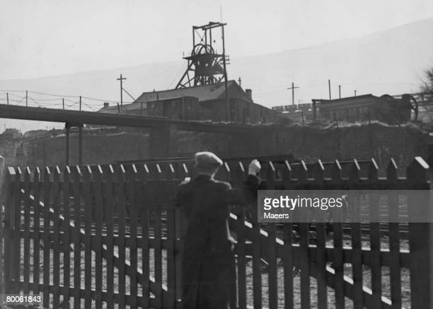 A man looks over a fence to the deserted Gorki pit near Mountain Ash Glamorgan south Wales during a strike over pay by 100 000 miners 9th March 1944