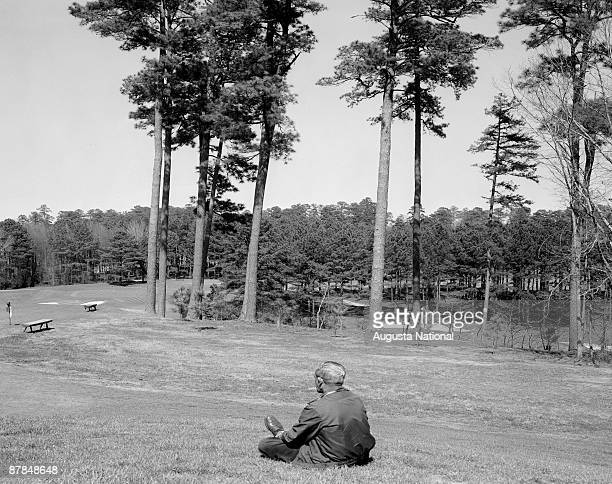 A man looks over a general view of the sixth hole at Augusta National Golf Club in April 1956 in Augusta Georgia