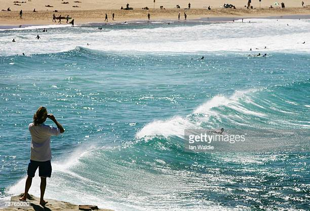A man looks over Bondi Beach during the beach's closure following a tsunami warning on April 2 2007 in Sydney Australia All of New South Wales'...