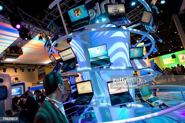 Man looks over computers in the Intel booth at the 2008 International Consumer Electronics Show at the Las Vegas Convention Center January 8, 2008 in...