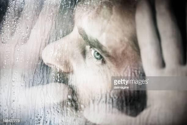 Man looks pressed against the Window, Rain
