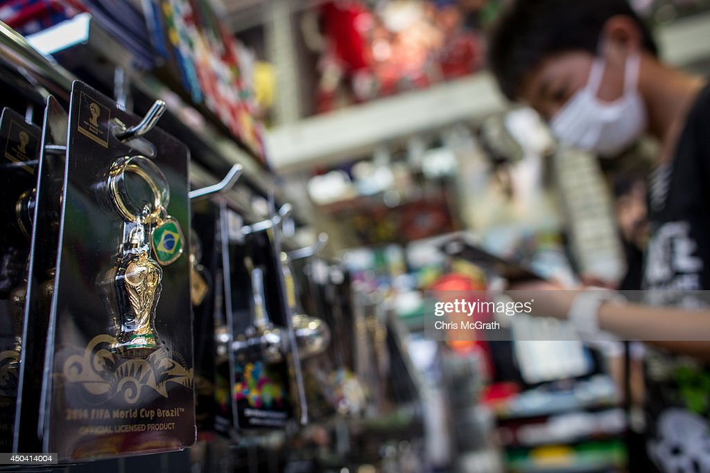 A man looks shops for Japan World Cup team merchandise and FIFA World Cup 2014 merchandise at a football store on June 11, 2014 in Tokyo, Japan. The World Cup 2014 in Brazil will begin on June 12th with the first match between Brazil and Croatia.