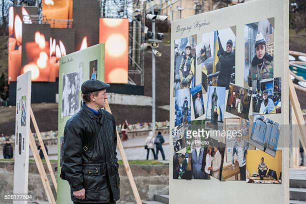 Man looks the photographic stage in Maidan square for the 2nd anniversary of Euromaidan unrest in Kiev Ukraine