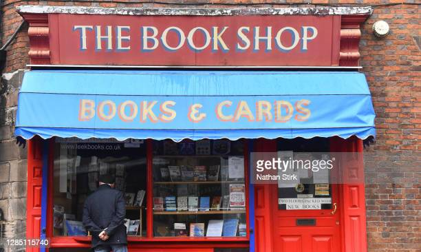Man looks through a book shop window which is closed on November 11, 2020 in Leek, England. The Booksellers Association has called on the government...