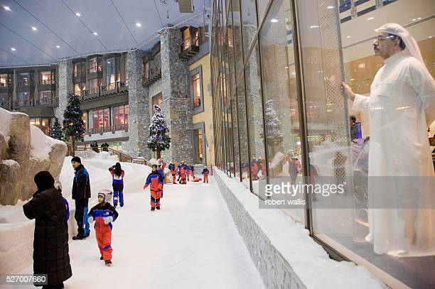 A man looks through a window at children playing at Ski Dubai at the Mall of the Emirates AlSoufouh Dubai Ski Dubai is the Middle East's first indoor...