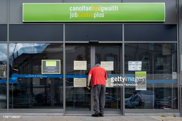 Man looks through the window of the Job Centre Plus on August 18, 2020 in Bargoed, Wales. The Office For National Statistics reported the UK's GDP...