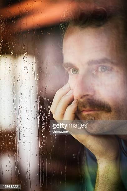 Man looks through the Window, Rain
