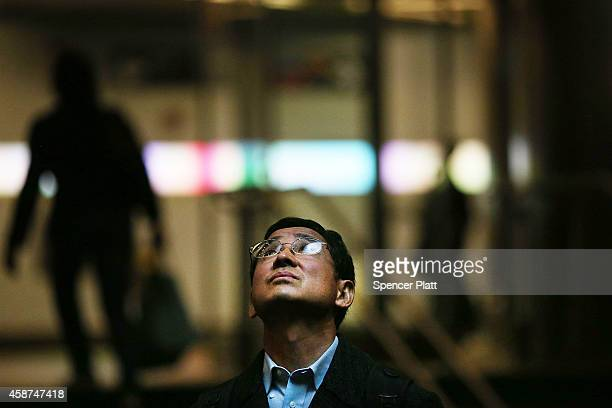 A man looks up at the newly opened Fulton Center train station in lower Manhattan on November 10 2014 in New York City The station was scheduled to...