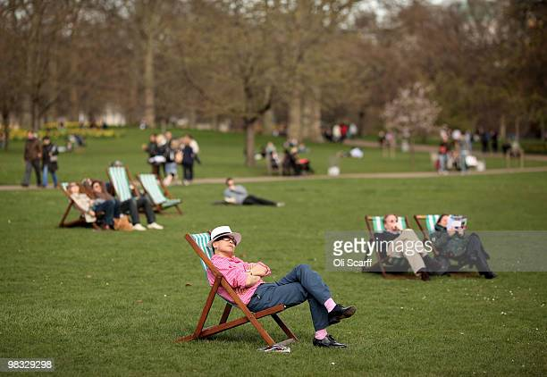 A man looks up at the sun from a deckchair in the warm spring weather in St James's Park on April 8 2010 in London England Temperatures in Britain...