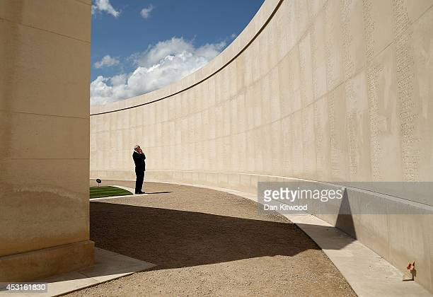 Man looks upon the names of the dead prior to a Candlelit Vigil to mark the centenary of the First World War, at The National Memorial Arboretum on...