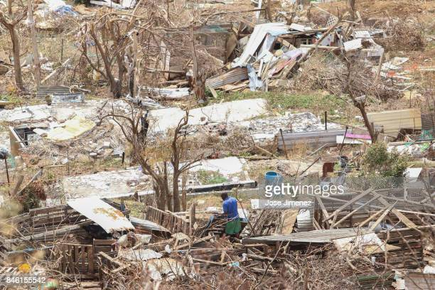 A man looks what is left of his home in Cay Bay Saint Maarten days after this Caribbean island sustained extensive damage after the passing of...