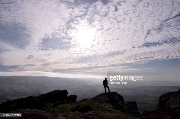 Man loom on over the Roaches in the Peak District on November 06, 2020 in Leek, Staffordshire .