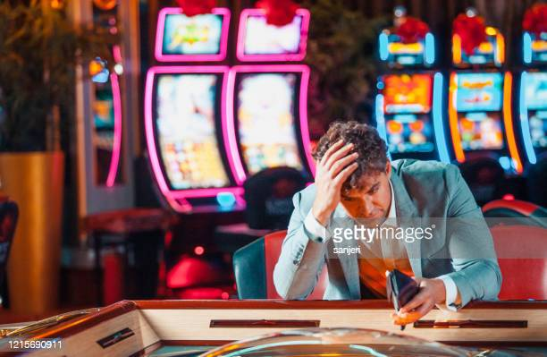 man loosing his money in the casino - gambling addiction stock pictures, royalty-free photos & images